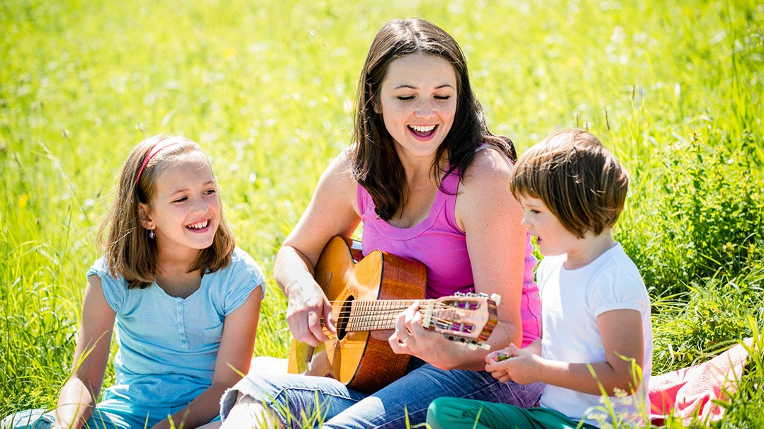 Staff and kids playing guitar